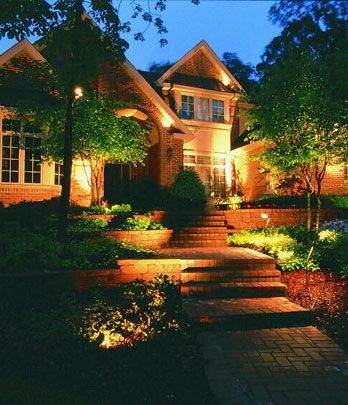 """Combine Beauty & Function- For example, adding lighting to plantings along a pathway breaks up the """"runway"""" look of too many lights strung alongside a walk.    Read more: http://www.houselogic.com/home-advice/lighting/outdoor-lighting-curb-appeal-and-safety/#ixzz2YZtejUhF"""
