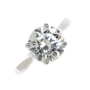 LOT:180   An 18ct gold diamond single-stone ring.