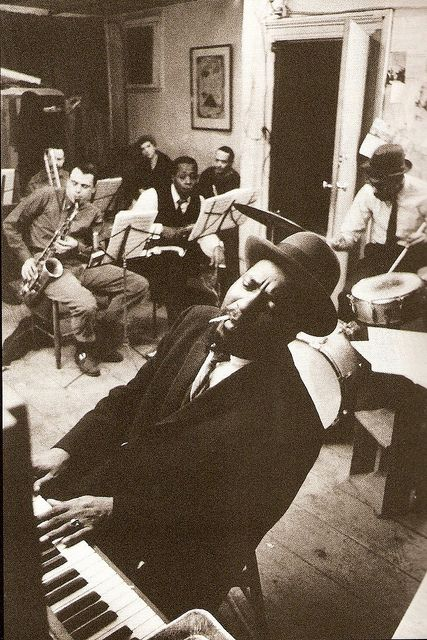 Thelonious Monk rehearsing in a New York loft with saxophonists Phil Woods and Charlie Rouse, 1959.