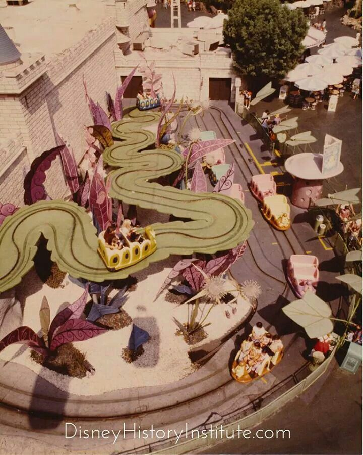 Disneyland Skyway gondolas cast shadows on the Alice in Wonderland attraction as…