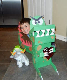 Shoebox, cereal box, and cardboard cut-outs to make this awesome dinosaur valentine box for Allan for school