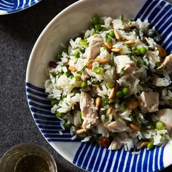 Chicken and Rice Salad with Pine Nuts and Lemon   We like to serve this Mediterranean-inspired salad warm, but it's also good slightly chilled. Be sure to check the seasonings, though; cold dishes often need more salt and pepper than those served hot.