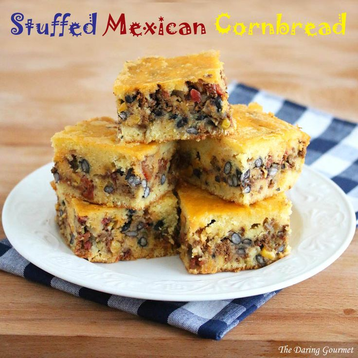 Stuffed Mexican Cornbread. Filled with ground beef, chorizo, tomatoes, corn, beans, and a whole host of delicious spices and flavors! Perfect!