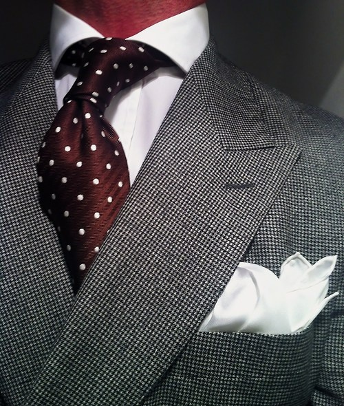 Houndstooth double breasted suit by Scabal fitted by Lowet Tailors, white shirt by New and Lingwood, brown Tom Ford tie a silk Charvet square