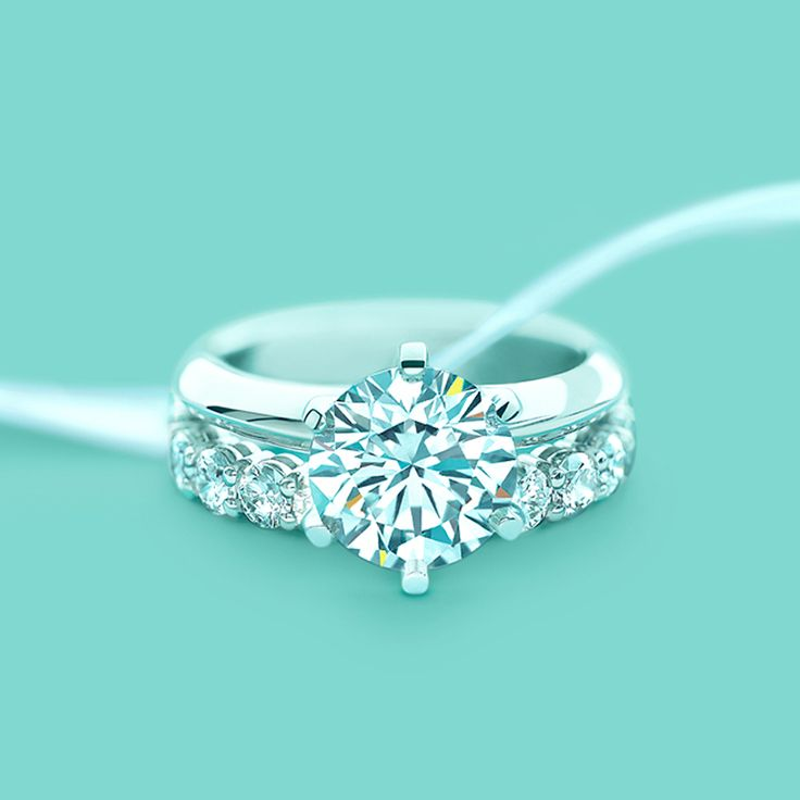The Tiffany® Setting engagement ring with a shared-setting diamond band ring. #TiffanyPinterest #WeddingBand