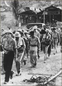 American POWs at the beginning of the Bataan Death March.  Philippines, 1942.
