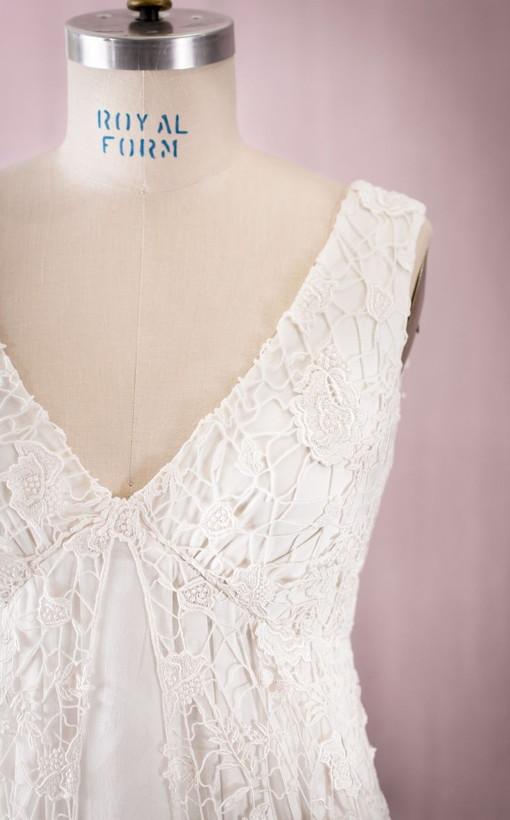 Wonderfully textured guipure lace with an embroidered flower-and-leaf motif over a flowing, gathered layer of silk chiffon with a silk charmeuse lining. The textural quality and the empire waist give