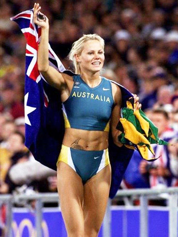 Australian athlete Tatiana Grigorieva celebrates after she won second place in the women's pole vault final at the Sydney Olympic Games.