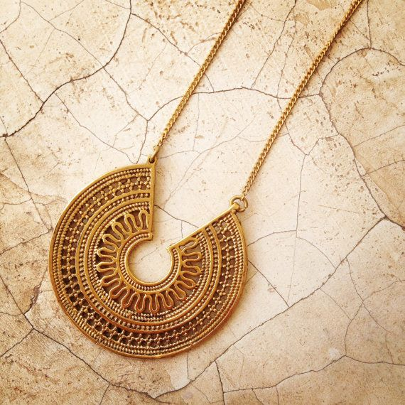 This brass necklace is modeled on an antique Rajasthani design which honours the hindu sun god Surya. The filigree and dot work is inspired by