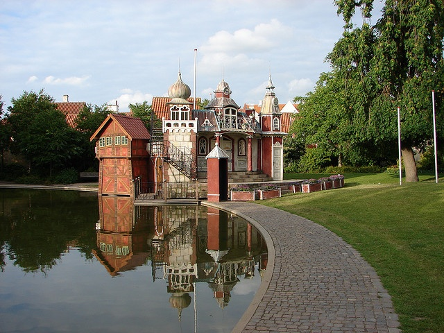 Fairy tale castle or an enchanted house next to a pond in the garden of the H.C. Andersen Museum, Odense, Denmark.