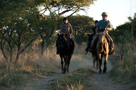 Arriving at camp on horseback