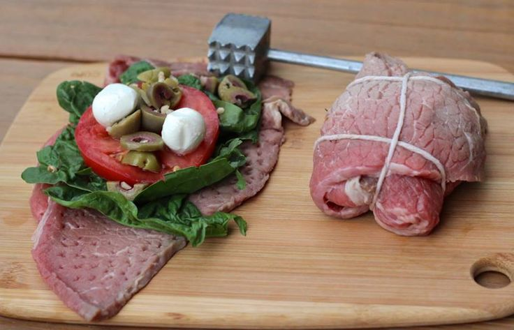 Stuffed Meat = amazing Paleo dinner!! (this one has spinach, tomato, green olives, garlic, olive oil, and fresh mozzarella {opt - not paleo}, wrapped in skirt steak)