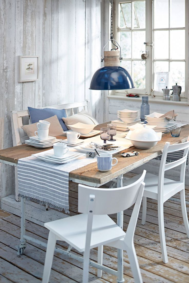 Coastal Dining Table With A Low Haning Pendant Light Cutre Decor And Striped Runner