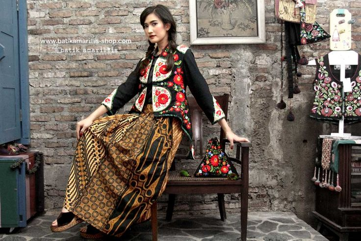 Batik Amarillis's Arcana embroidery jacket which features hungarian stumblework embroidery style to create 3d wffect!Stand out in the crowd with this unique and stunning jacket!this contemporary & yet vintage style is accented with exquisite full Hungarian embroidery also features 4 triangle arcana tassels to complete the whole extravangant work of art!.