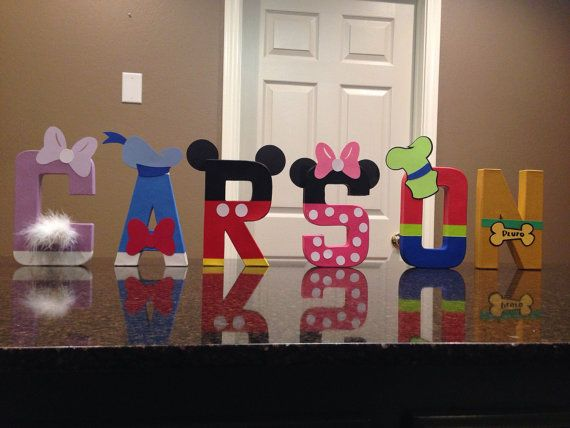These are priced per letter  Please make sure to order to correct quantity of letters from the drop down box to spell the name you would like. Please put the name and any special instructions you have in the notes section  These custom made letters are painted and decorated to look like the Mickey Mouse Club Characters and are 8 tall. These are lightweight and made of mâché material. They can stand on their own except for the letters F, J, P  Due to the fact that so many of these hats, ears…