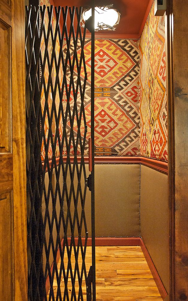 Elevator Cab Upholstered Above Chairrail In Antique Kilim