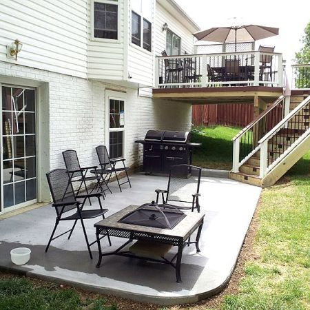 Love this - 2nd level deck, first level patio... room for a shed or workshop or something underneath the deck too
