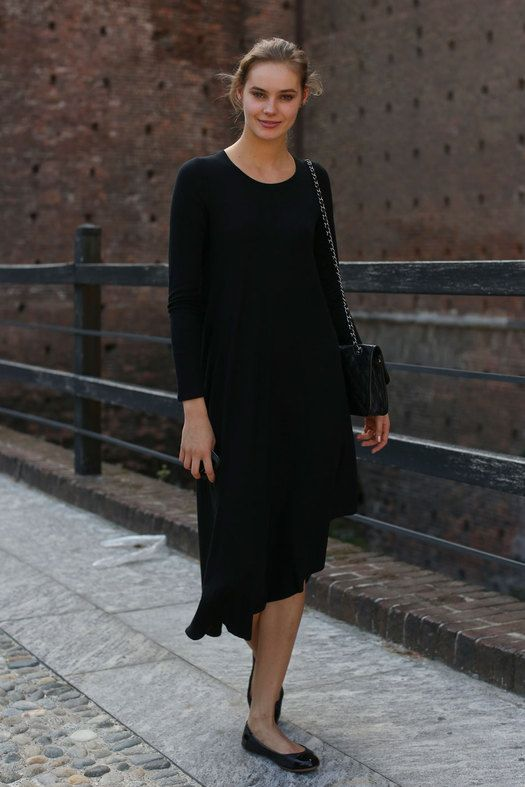 Milan: Relaxed black dress and flats. Feminine, simple, and elegant.