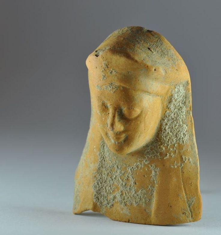 Kore protome, Greek terracotta kore protome, 6th century B.C. Magna Graecia, Greek pottery votive protome goddess, 10.7 cm high. Private collection