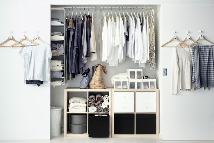 Reach-in closet space with sliding doors and IKEA furniture and fittings. #closet