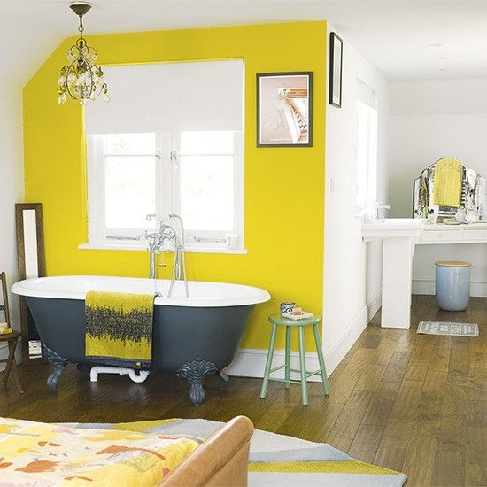 Bedroom with yellow painted feature wall | Bedroom paint ideas | housetohome.co.uk