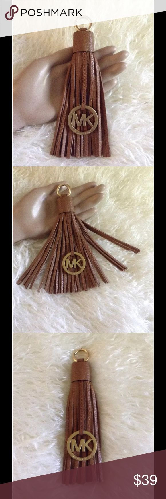 AUTHENTIC MICHAEL KORS TASSEL KEYCHAIN TAG FOB Gorgeous Michael Kors leather Tassel Charm tag.  Use as a keychain, bag charm, a Car charm, Fob, Luggage or attach to your Dog's Leash For A Posh look!  The color of the brown is Acorn.  Please compare to other MK tassel keychains that do not have the MK charm attached. Please don't forget to visit my eBay store where I offer free shipping! Smoke free home! Michael Kors Accessories Key & Card Holders