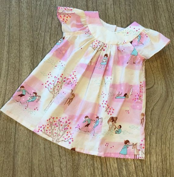 This lovely dress is perfect for any occasion. It is comfortable, and a bit twirly. It has two small buttons in the back. A white diaper cover isincluded,
