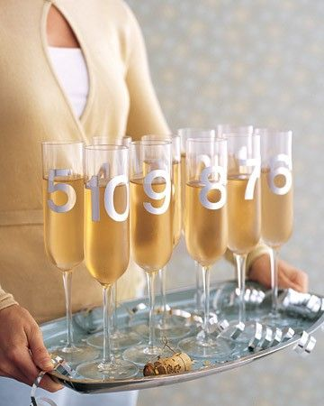 New year's Eve party idea: Have some fun with the countdown toast! Add numbers to the glasses, then have each person lift their glass when their number is chanted.