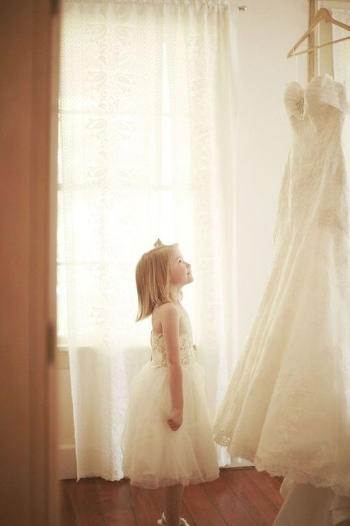 Take picture of daughter looking up, wearing baptism dress then save for adding day and take pic of wedding dress hanging up, photo shop together! Or use mothers wedding dress!