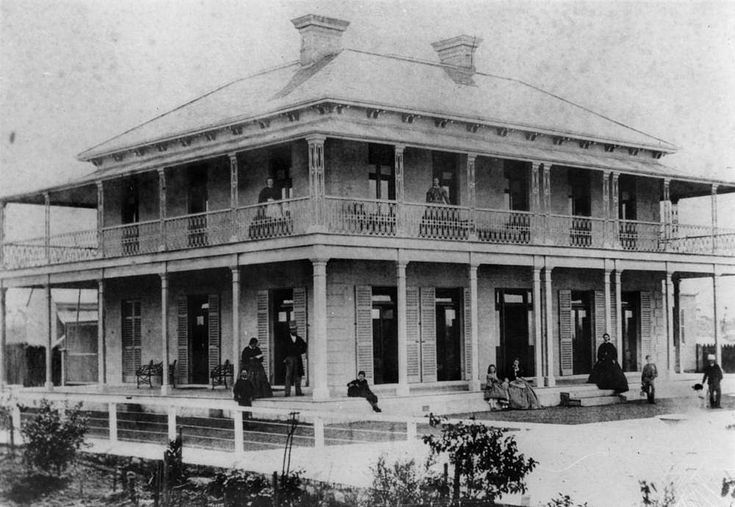 Beaumont, an imposing residence at Ipswich, ca. 1870 - This large homestead is two storeys, with a verandah surrounding both levels. There are shutters on the lower level French doors, leading on to the verandah. Beaumont was built for George Harrison Wilson, a prominent merchant of Ipswich. Mr Wilson is the gentleman wearing the top hat, standing near the post on the veranda to the left. He had a large family of nine children.