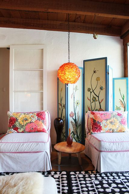 Love the chairs with floral pillows