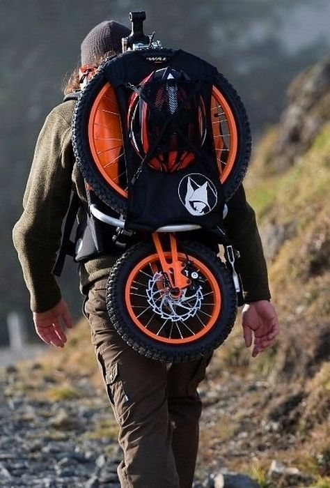 Take a hike up the mountain. And then spread your wings and fly down on wheels ... back pack bike