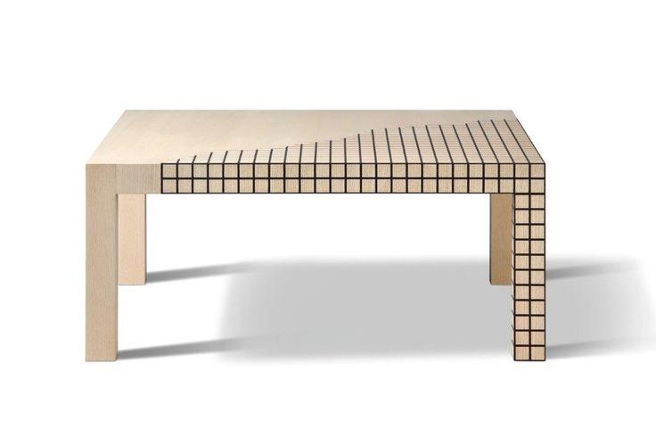 """FRAMMENTO MISURA. è una donazione di Adolfo Natalini al MAAM - Museo della Fondazione Aldo Morelato. Il tavolino è una rivisitazione di un pezzo che lo stesso architetto aveva disegnato negli anni '70. Il mobile è interamente realizzato in legno di frassino con intarsi in wengé che vanno a ricreare dei piccoli """"quadri"""". L'effetto che si crea è una rete di geometrie perfette che ricoprono e decorano parte del piano d'appoggio. Design: Aldolfo Natalini"""
