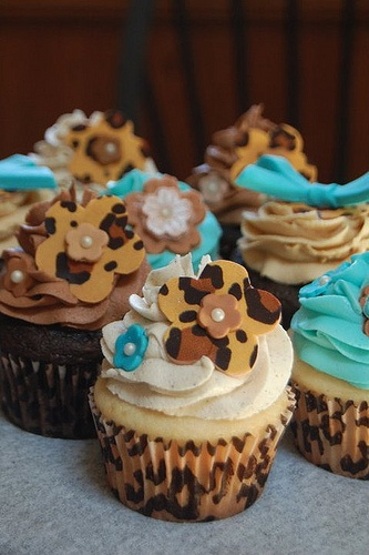 Cupcakes w/ cheetah print flowers and wrappers and aqua accents