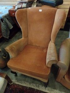 Basement 7 - Provenance Auction House: An Upholstered Wing Back Chairs.