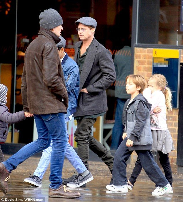 Out and about: Brad Pitt with son Maddox (in blue jacket) and twins Knox and Vivienne were...