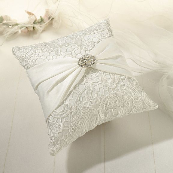 A Ring Bearer Pillow that will bring you back to a simpler time. This pillow will hold your wedding bands safely and look great in your vintage inspired wedding. This cream pillow is incased in a stun