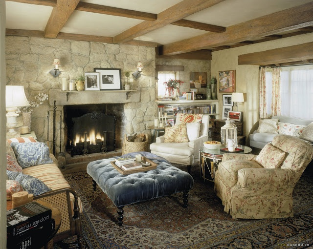 """Living room of Rosehill Cottage in the movie """"The Holiday"""".  Love that big blue velvet tufted ottoman!  The charming cottage's interior:  sets on a soundstage.  The exterior was a shell constructed for the movie then torn down."""