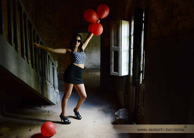 Old abandoned house. Fashion fotography. red baloons. Old building