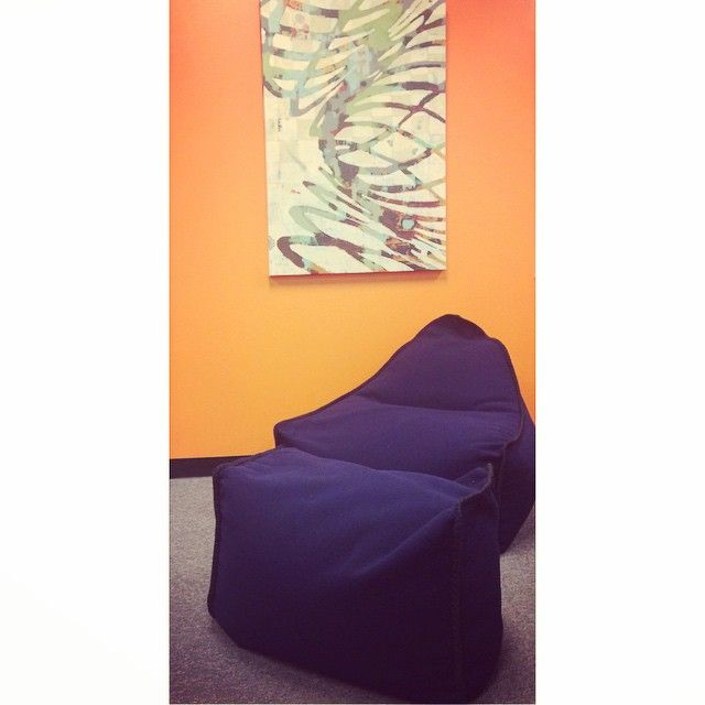 Our navy blue Bodhi bean bag chair looks great contrasted against the Orange walls of our office! Its #hemp upholstery makes this piece comfortable and will bring a #fresh look to any room!