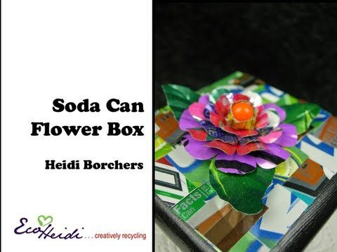 In this video, EcoHeidi Borchers creates a multi-layered flower from soda cans and Aleene's Tacky Dot Singles. A super cool way to upcycle and recycle your soda cans into fun art. For more ideas, instructions and inspiration go to http://cool2craft.com