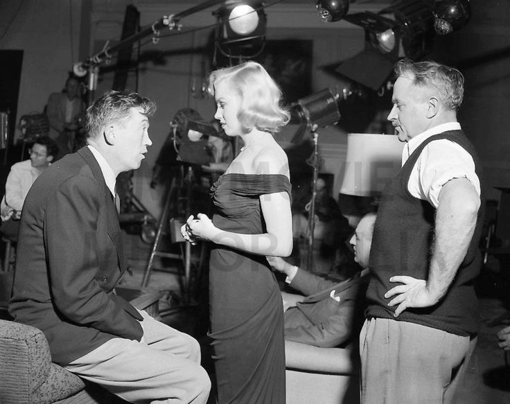 Marilyn Monroe listening to director John Huston during the filming of The Asphalt Jungle, 1950