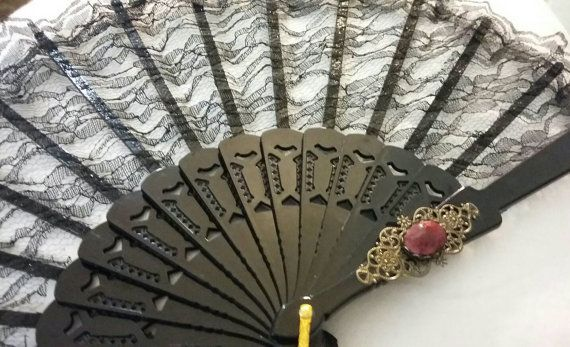 Check out this item in my Etsy shop https://www.etsy.com/listing/488800873/gothic-victorian-black-lace-fan-with