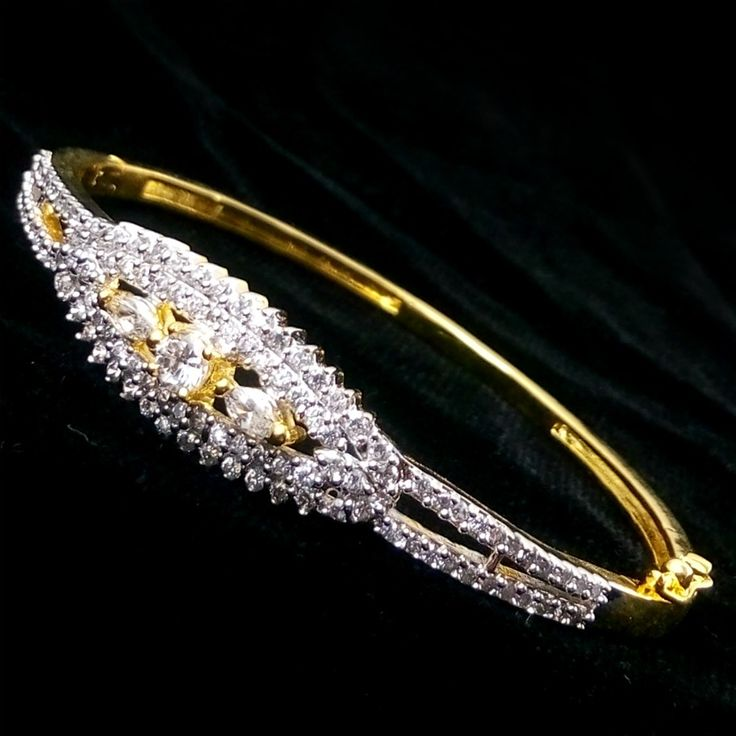 Designer Sparkling American Diamond Wedding Sleek Gold Plated Bracelet / Kada / Bangle Beautifully hand crafted bracelet bangle Sparkles like real diamond gold bracelet bangle High quality American Diamonds are used Sleek fit bracelet Free size - fits every hand Gold plated bracelet bangle