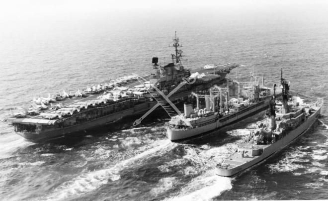 US Navy Aircraft Carrier USS Midway (CV-41) being replenished by Oiler USNS Navasota (T-AO-106); also receiving fuel is the Guided Missile Cruiser USS England (CG-22), Nov. 1983.