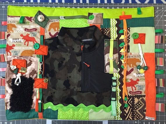 This Fidget Quilt or Activity Blanket is a lap quilt that provides sensory and tactile stimulation for the restless hands of someone with Alzheimer, other forms of Dementia, Autism, or people who experienced a stroke. The quilt is made with a variety fabric textures, prints, and