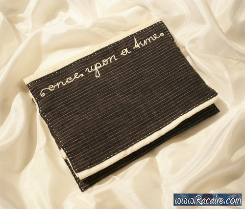 sew a book cover and embroider it