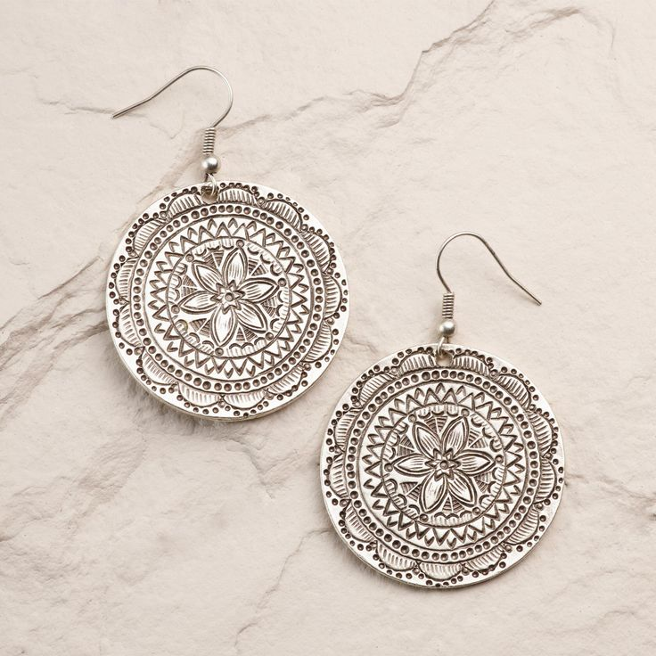 Handcrafted by one of our favorite local artisans in Istanbul, this pair looks like it was found in an open-air Turkish market. With an intricately etched mosaic design and an antique silver finish, our earrings possess a global spirit.
