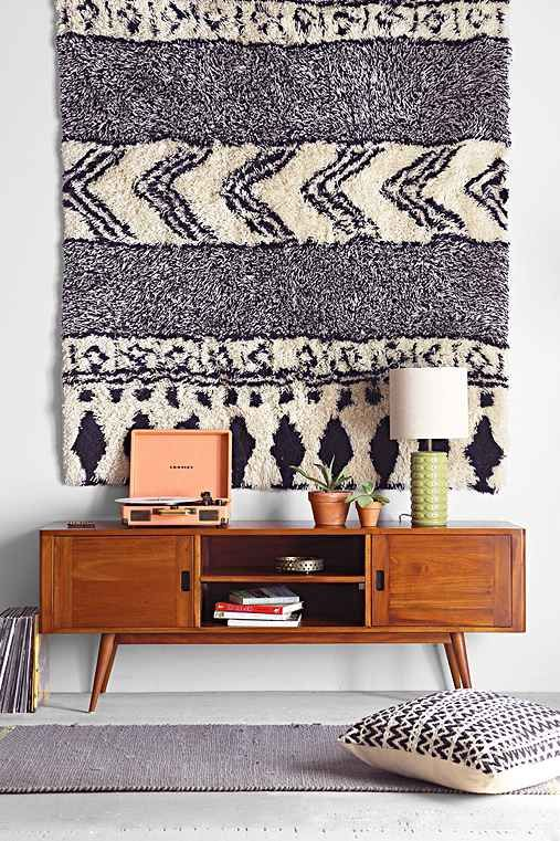 shag rug as a wall hanging...my heart belongs to the mid-century style cabinet! <3