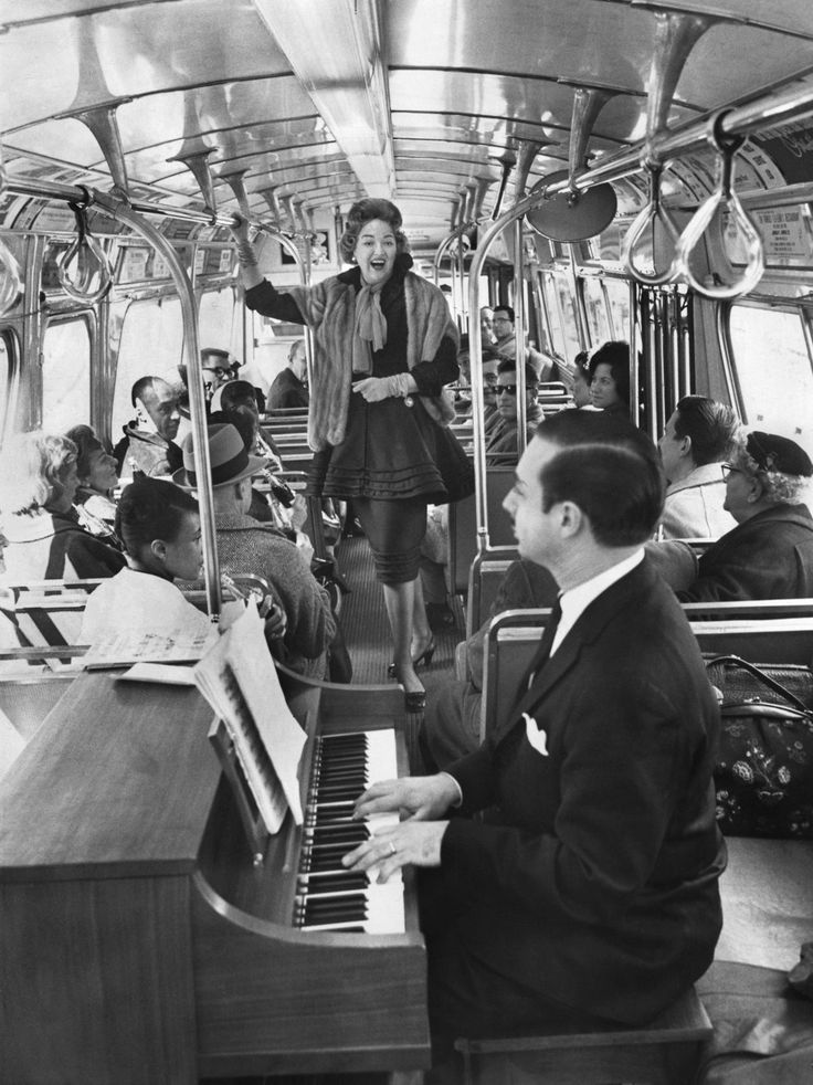 """Campaign to """"put the new in Newark"""" with a conductor-pianist and a mezzo-soprano on a NJ commuter bus. The ride along the NJ Turnpike and concert were free, 1963."""